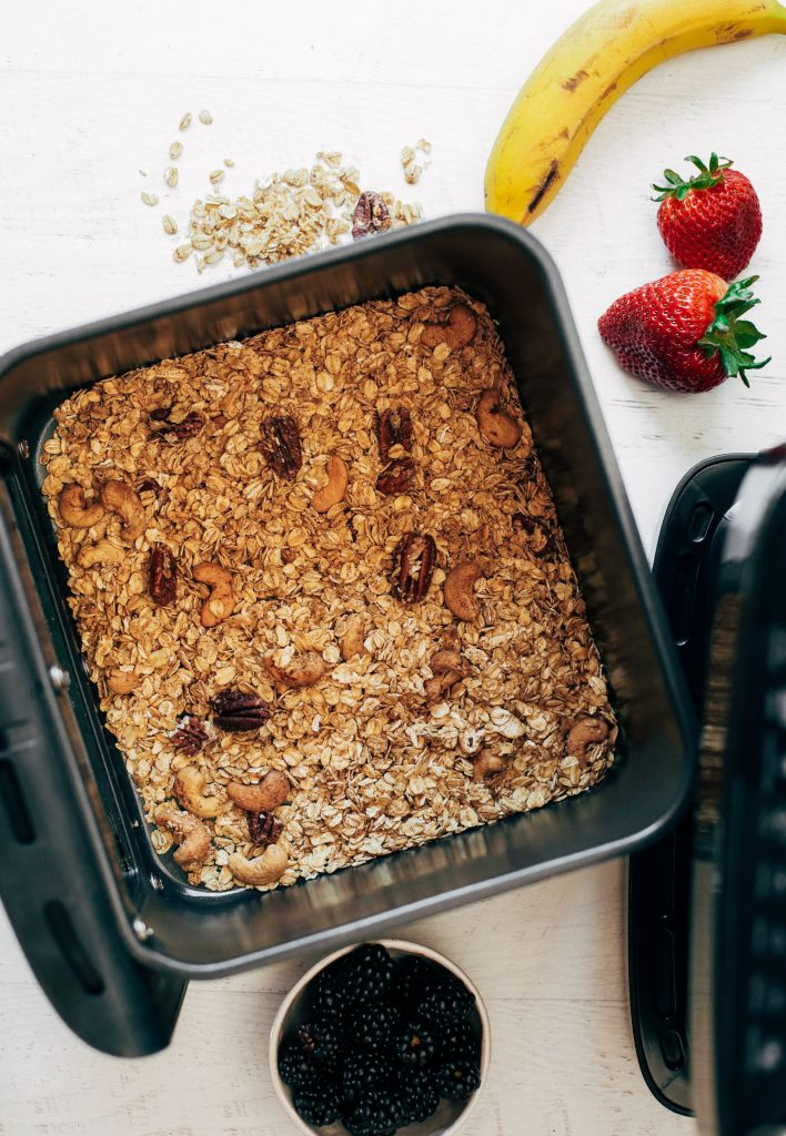 Healthy cinnamon pecan granola made in the air fryer. In just a few minutes, you can have a bowl full of delicious gluten free granola and can serve it with almond or oat milk! Made with just a few ingredients and in just a few minutes, then it's ready to go!